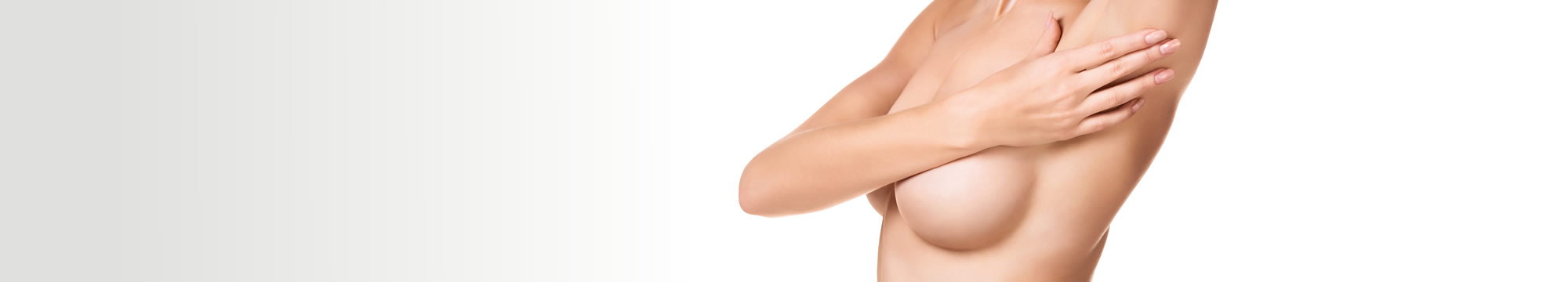 Naked woman's breasts covered with a hand